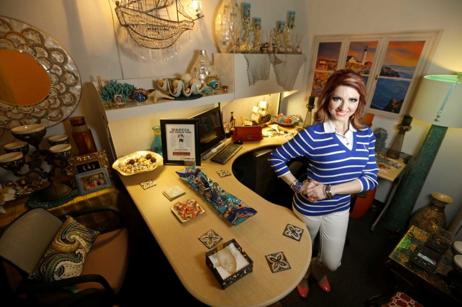 Yasmine Haddad, an partner professor during a University of Texas School of <b>Dentistry</b>, brought a sea into her windowless office. Photo: Melissa Phillip, Staff / © 2014  Houston Chronicle