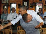 U.S. President Barack Obama is hugged and picked adult by Scott Van Duzer during Big Apple Pizza and Pasta Italian Restaurant in Fort Pierce